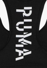 Puma - RUNTRAIN - Sportovní podprsenka - black - 2