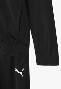 Puma - SUIT - Trainingsanzug - black
