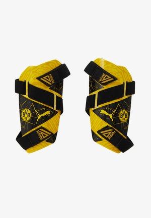 BVB BORUSSIA DORTMUND FUTURE GUARD - Shin pads - cyber yellow/puma black