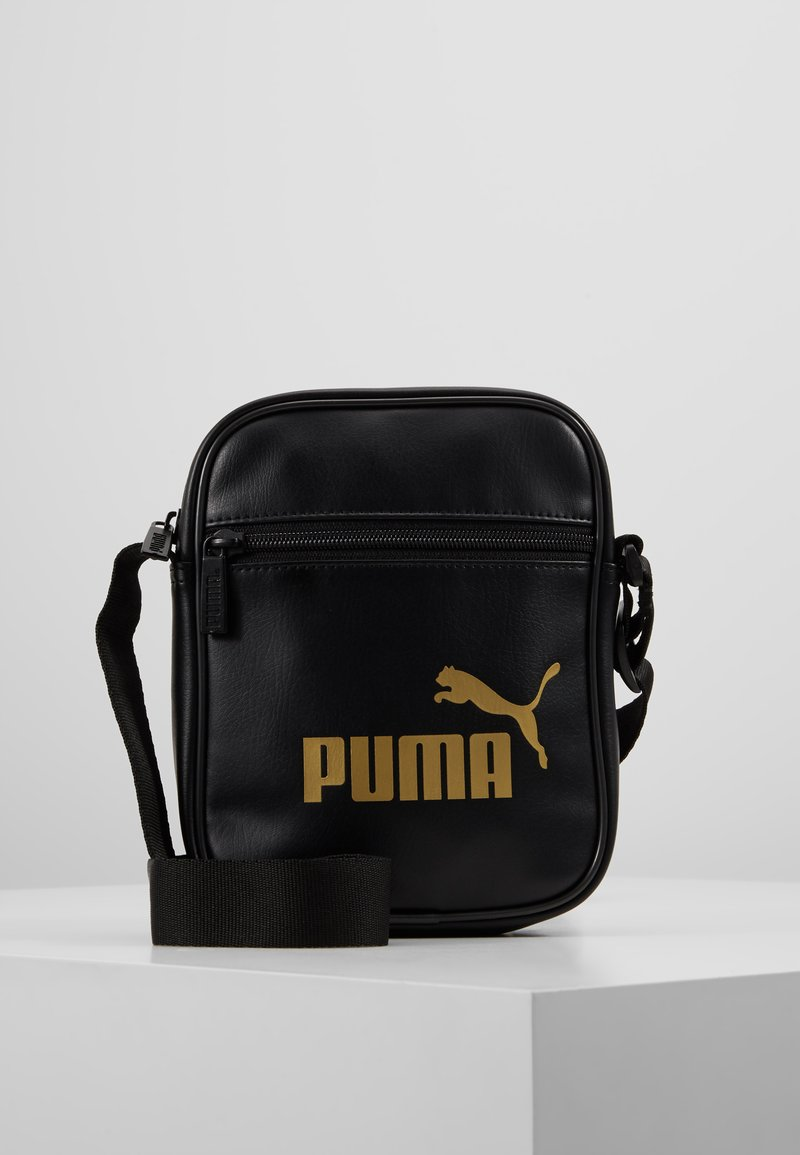 Puma - CORE UP PORTABLE - Across body bag - black/gold