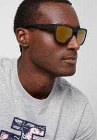 Puma - Sluneční brýle - black - 1