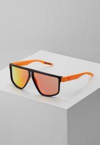 Puma - Sunglasses - black/orange/red - 0