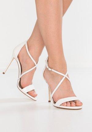 High heeled sandals - glitter/bone