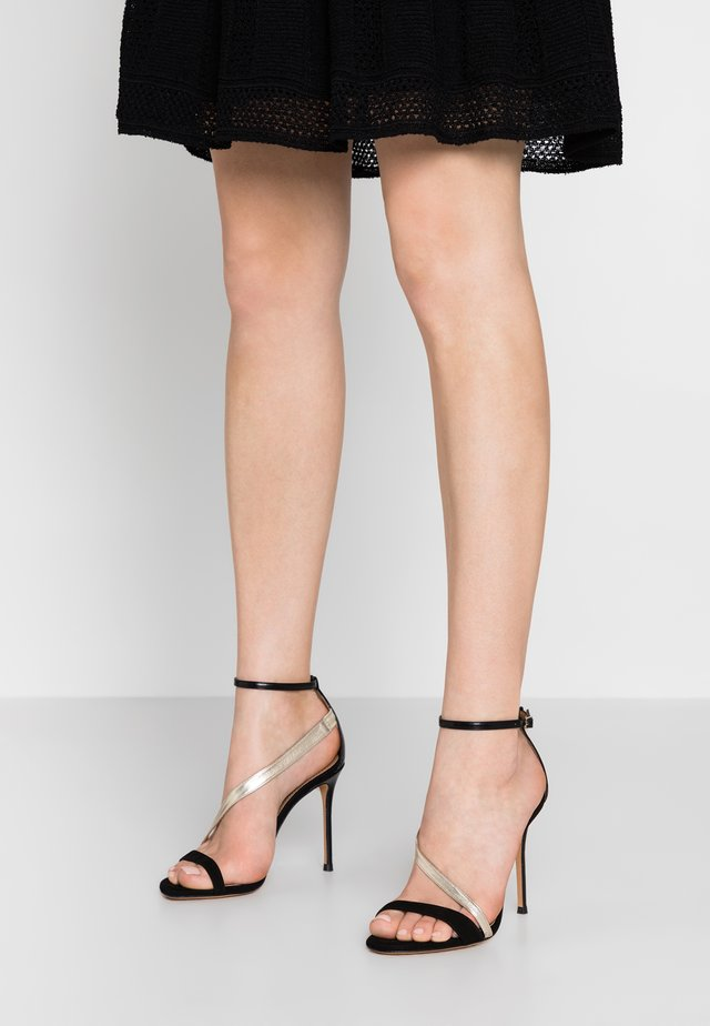 High heeled sandals - black/platin