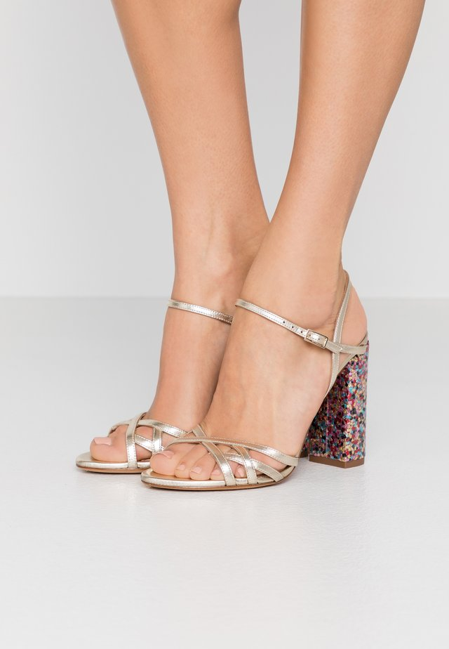 High heeled sandals - metal platin/fun