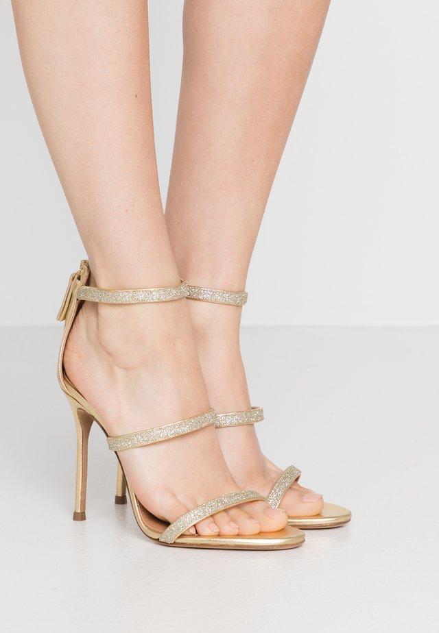 High heeled sandals - glitter gold/metal gold