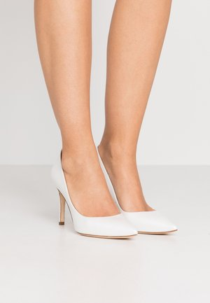 Zapatos altos - glow bone