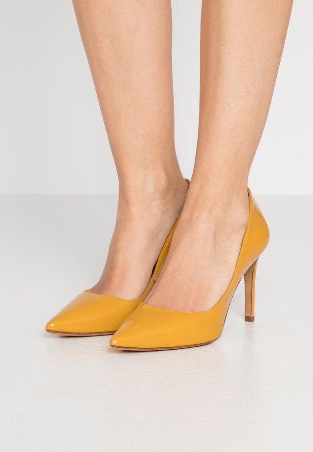 Høye hæler - mustard