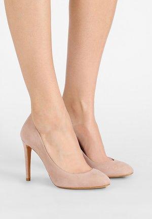 Zapatos altos - face