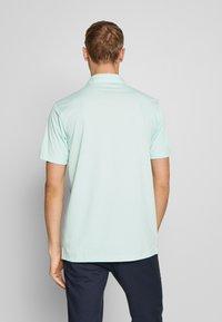 Puma Golf - ROTATION  CRESTING - T-shirt de sport - mist green - 2
