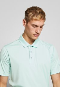 Puma Golf - ROTATION  CRESTING - T-shirt de sport - mist green - 3