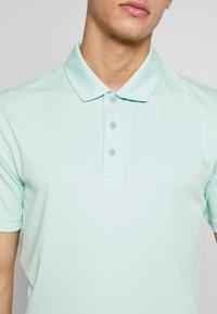 Puma Golf - ROTATION  CRESTING - T-shirt de sport - mist green - 5