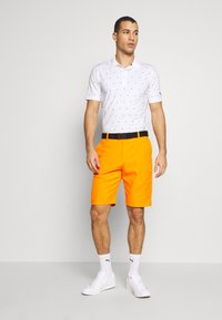 Puma Golf - JACKPOT - Korte sportsbukser - vibrant orange - 1