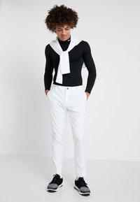 Puma Golf - TAILORED JACKPOT PANT - Tygbyxor - bright white - 1