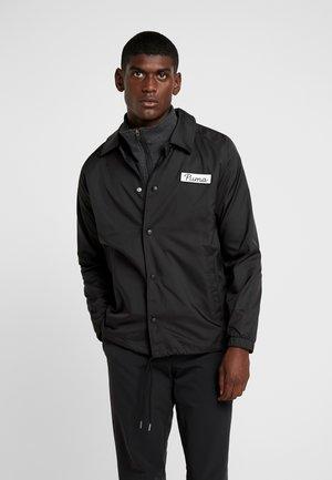 COACHES JACKET - Vodotěsná bunda - black