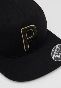 Puma Golf - RICKIE FOWLER YEAR - Pet - black/gold - 5
