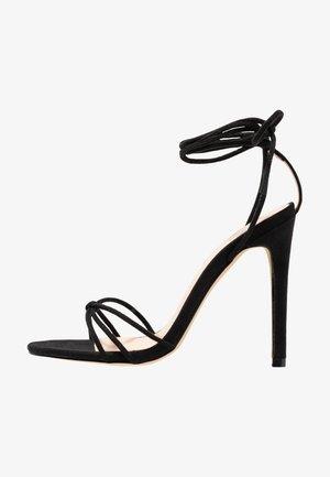 FLEUR - Sandales à talons hauts - black