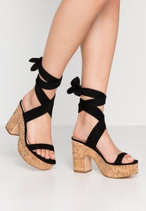 NAÏVE - Sandalen met hoge hak - black