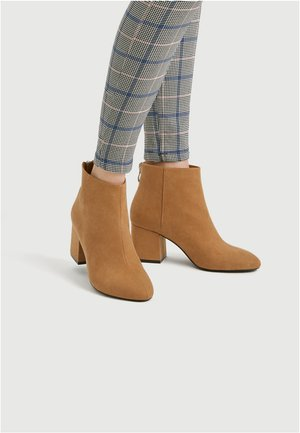 High heeled ankle boots - light brown
