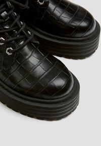 PULL&BEAR - Platform ankle boots - black - 7