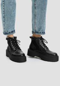 PULL&BEAR - Platform ankle boots - black - 0