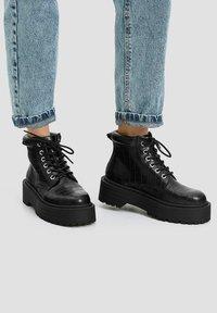 PULL&BEAR - Platform ankle boots - black - 9