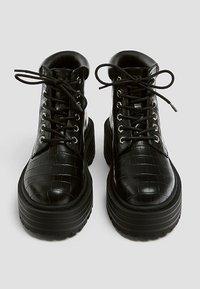 PULL&BEAR - Platform ankle boots - black - 5