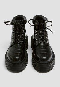 PULL&BEAR - Platform ankle boots - black - 10