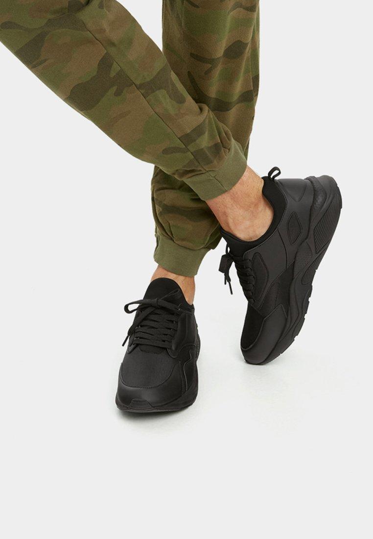 PULL&BEAR - MIT SOCK-BOOTS XDYE - Sneaker low - black