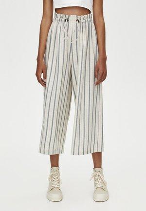 MIT SENFFARBENEM - Trousers - white