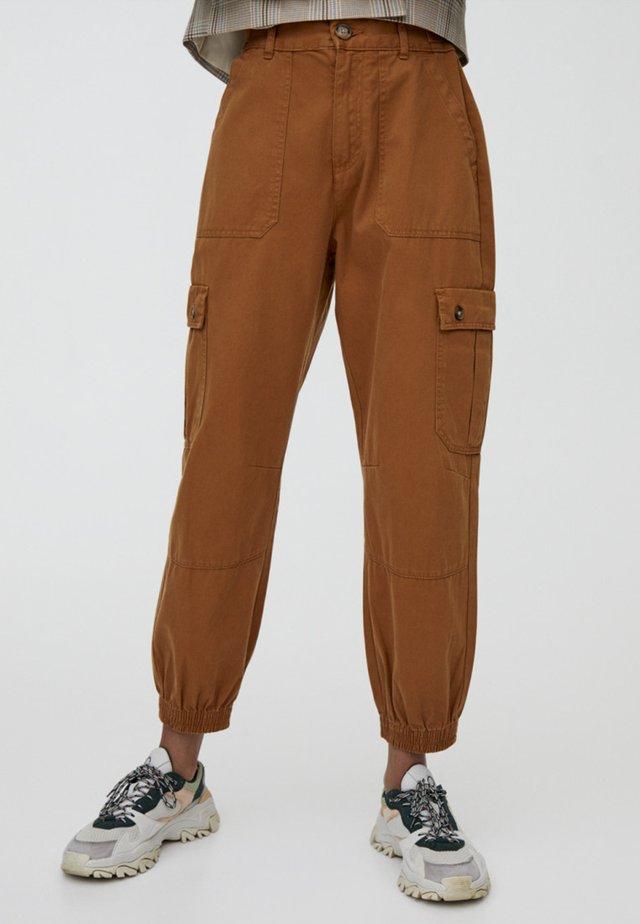 CARGO  - Reisitaskuhousut - brown