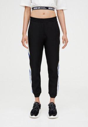 MIT FARBLICH - Pantaloni sportivi - black