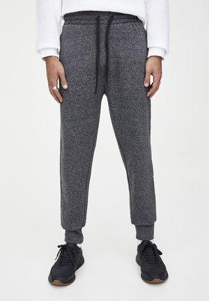 MIT ZIERNÄHTEN - Teplákové kalhoty - dark grey