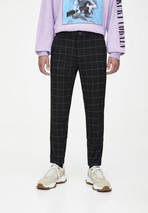 MIT KAROMUSTER - Pantalon classique - black