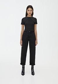 PULL&BEAR - MIT HOHEM BUND - Straight leg jeans - black - 1