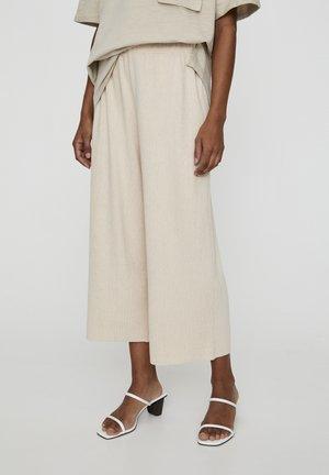 MIT TEXTUR  - Trousers - beige