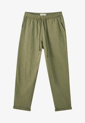 FLAMMENGARN-HOSE MIT STRETCHBUND - Teplákové kalhoty - khaki