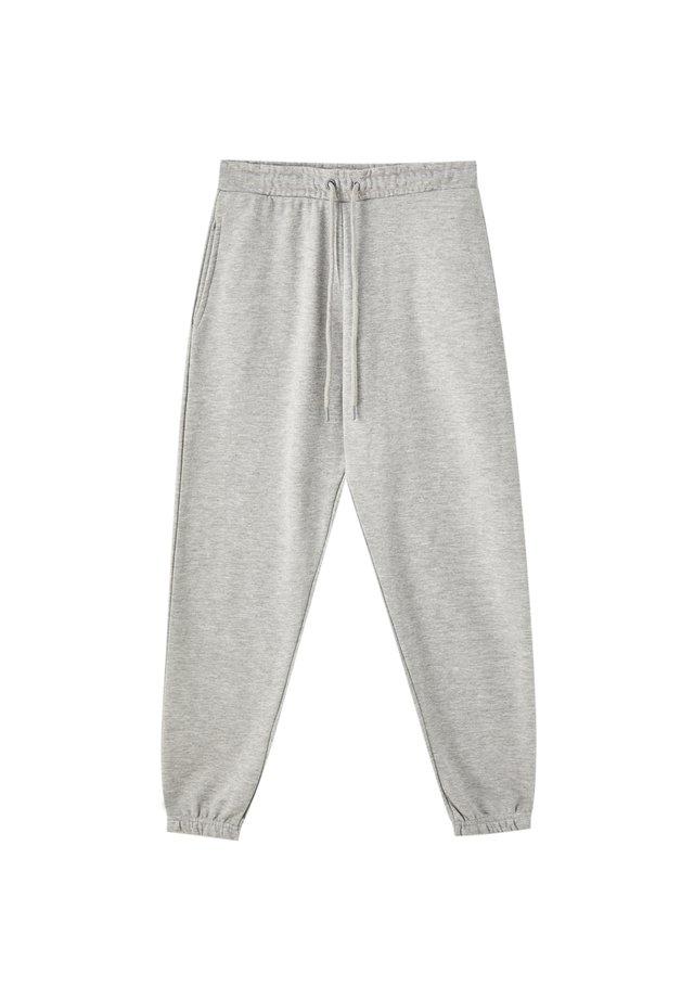 MIT GUMMIZUG AM SAUM - Spodnie treningowe - light grey