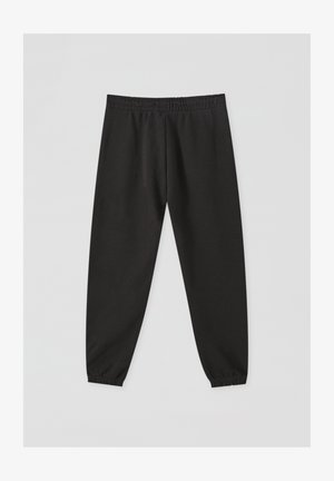 MIT GUMMIZUG AM SAUM - Tracksuit bottoms - black