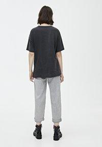 PULL&BEAR - TIMON AND PUMBAA - T-shirt print - black - 2