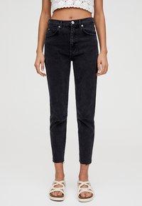 PULL&BEAR - MIT HOHEM BUND - Slim fit jeans - black - 0