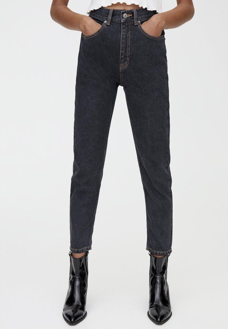 PULL&BEAR - MIT HOHEM BUND - Slim fit jeans - black