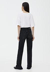 PULL&BEAR - MIT HOHEM BUND - Straight leg jeans - black - 2