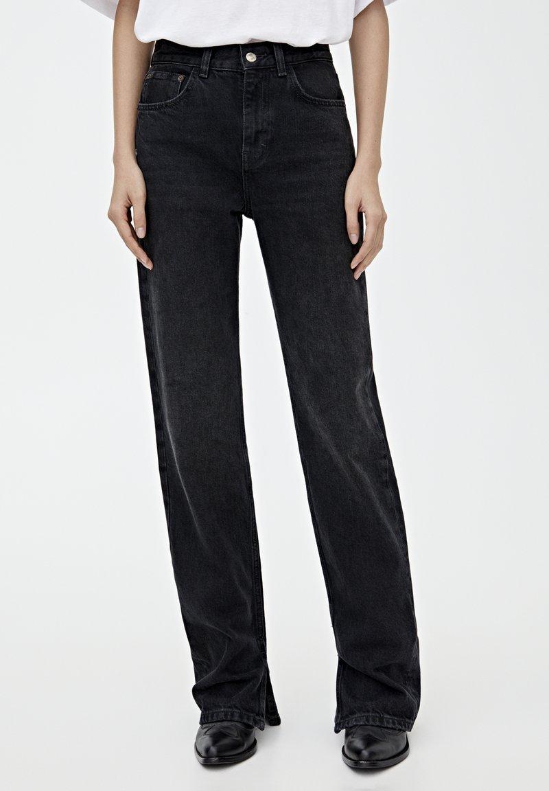 PULL&BEAR - MIT HOHEM BUND - Straight leg jeans - black