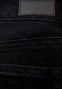 PULL&BEAR - MIT HALBHOHEM BUND - Jeans Skinny Fit - black - 5