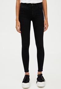 PULL&BEAR - MIT HALBHOHEM BUND - Jeans Skinny Fit - black - 0