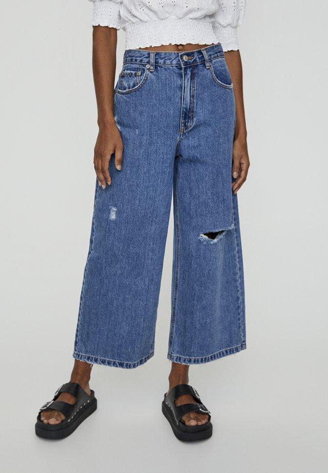MIT ZIERRISSEN - Jeans a zampa - dark blue