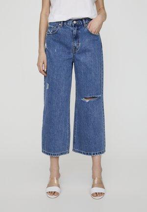 MIT ZIERRISSEN  - Jeans a sigaretta - mottled light blue