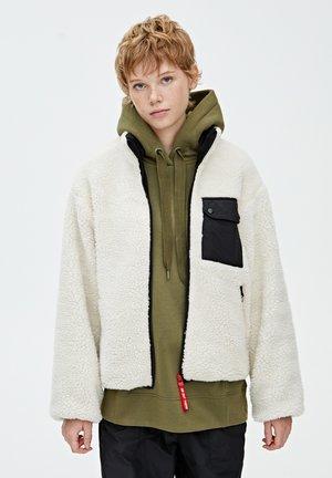 MIT FARBLICH ABGESETZTER - Winter jacket - beige