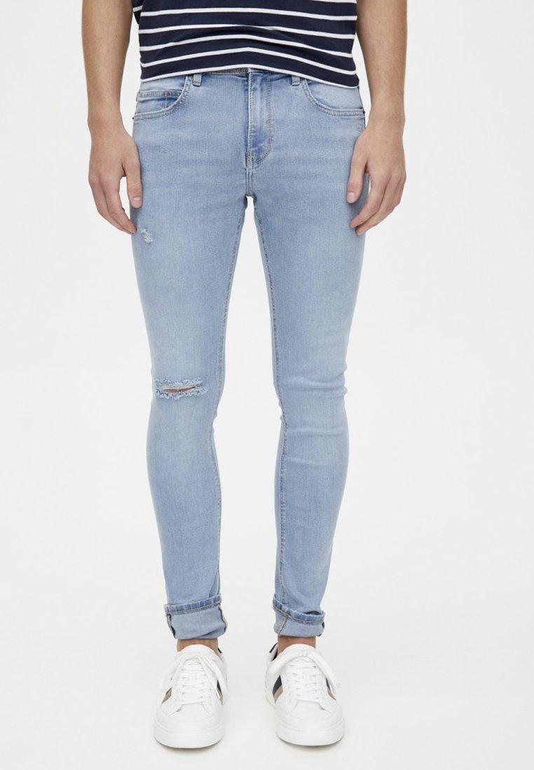 PULL&BEAR - MIT RISSEN - Jeans Skinny Fit - blue denim